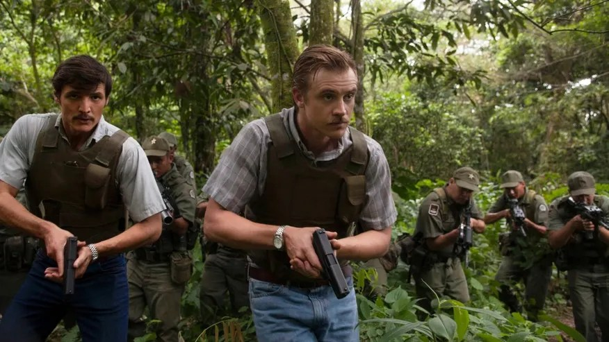 "This undated production photo provided by Netflix, shows actors Pedro Pascal, left, as Javier Pena, and Boyd Holbrook as Steve Murphy in the Netflix Original Series ""Narcos.""  The series that debuts on Aug. 28, 2015, is based on the account of Murphy and Pena, now-retired Drug Enforcement Administration agents who were assigned to bring the drug lord down. (Daniel Daza/Netflix via AP)"