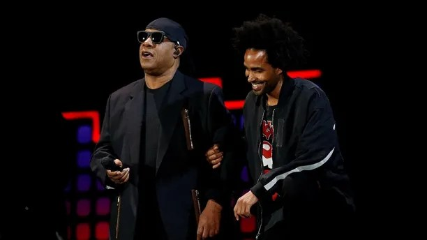 Singer Stevie Wonder takes two knees with the help of his son Kwame Wonder before performing at the 2017 Global Citizens Festival at Central Park in New York, U.S., September 23, 2017. REUTERS/Shannon Stapleton - RC15070EC410