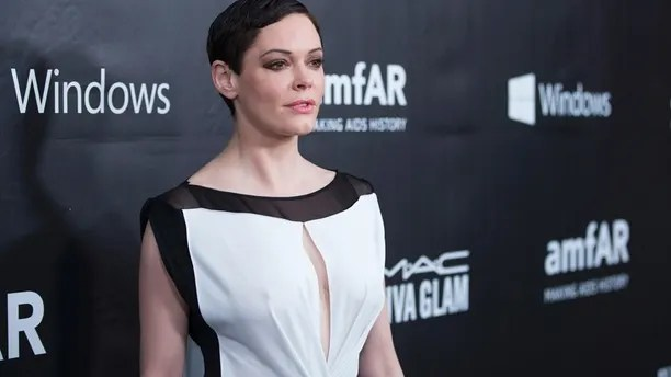 Actress Rose McGowan poses at amfAR's Fifth Annual Inspiration Gala in Los Angeles, California October 29, 2014.