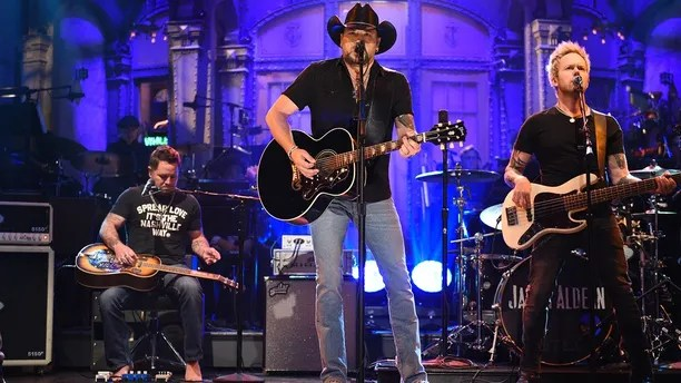 "In this photo provided by NBC, Jason Aldean performs ""I Won't Back Down"" on ""Saturday Night Live,"" Saturday, Oct. 7, 2017, in New York. ""Saturday Night Live"" has paid tribute to the victims of the Las Vegas mass shooting and the late rock superstar Tom Petty by opening its show with country star Aldean singing one of Petty's songs."
