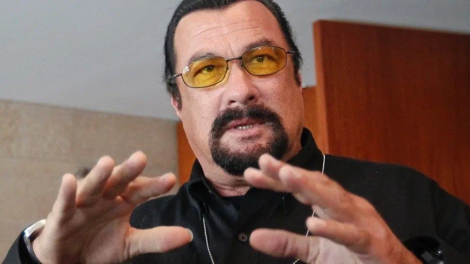 """FILE: A former actress said Steven Seagal harassed her on the set of """"Out for Justice."""""""