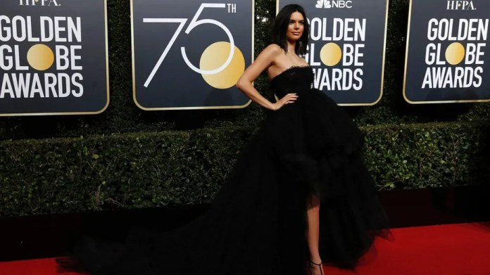 Kendall Jenner receives criticism for attending the 75th annual Golden Globe Awards.