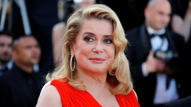 70th Cannes Film Festival - Event for the 70th Anniversary of the festival - Red Carpet Arrivals - Cannes, France. 23/05/2017. Actress Catherine Deneuve poses. REUTERS/Jean-Paul Pelissier - RC18061BEC50