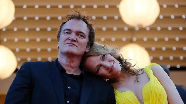 """Director Quentin Tarantino (L) and actress Uma Thurman pose on the red carpet they arrive for the screening of the film """"Sils Maria"""" (Clouds of Sils Maria) in competition at the 67th Cannes Film Festival in Cannes May 23, 2014. The film """"Pulp Fiction"""" will be presented on Friday during a beach front cinema screening for its 20th anniversary.                     REUTERS/Regis Duvignau (FRANCE  - Tags: ENTERTAINMENT)   - LR2EA5N1B42H9"""
