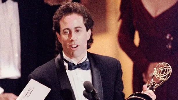 FILE PHOTO 19SEP93 - After a stunningly successful nine-year run, comedian Seinfeld has decided to stop production of his quirky hit television show at the end of this season in May, NBC said on December 26. Seinfeld holds the Emmy award for outstanding comedy series at the 45th annual Emmy Awards telecasting in this September 19, 1993 file photo.SEINFELD - RP1DRIDEFMAC