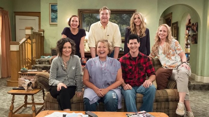 """ROSEANNE - """"Roseanne,"""" the timeless sitcom that broke new ground and dominated ratings in its original run, will return to ABC with all-new episodes, in a special hour-long premiere, TUESDAY, MARCH 27 (8:00-9:00 p.m. EDT). """"Roseanne"""" will air in its regular time slot, 8:00-8:30 p.m., beginning TUESDAY, APRIL 3. (ABC/Adam Rose) SARA GILBERT, LAURIE METCAF, ROSEANNE BARR, JOHN GOODMAN, MICHAEL FISHMAN, SARAH CHALKE, ALICIA GORANSON"""
