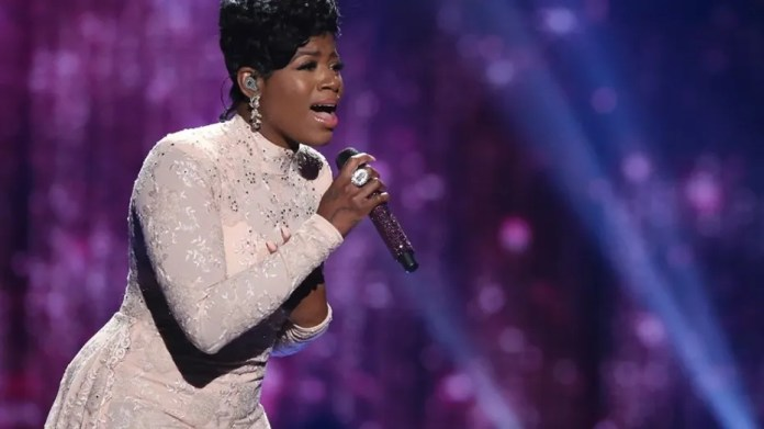 """In this April 7, 2016, file photo, Fantasia Barrino performs at the """"American Idol"""" farewell season finale at the Dolby Theatre in Los Angeles. Barrino canceled a scheduled concert in Memphis, Tenn., on March 5, 2017, due to what her husband said were second degree burns she suffered in an accident."""