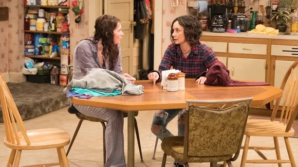 "ROSEANNE - ""Roseanne Gets the Chair"" - Roseanne's clash with Darlene over how she's raising her kids - especially Harris - reaches a breaking point; while Dan tries to help Roseanne with her bad knee by getting her an elevator chair, which she refuses to use because she doesn't want to admit getting old, on the second episode of the revival of ""Roseanne,"" TUESDAY, APRIL 3 (8:00-8:30 p.m. EDT), on The ABC Television Network. (ABC/Adam Rose) EMMA KENNEY, SARA GILBERT"