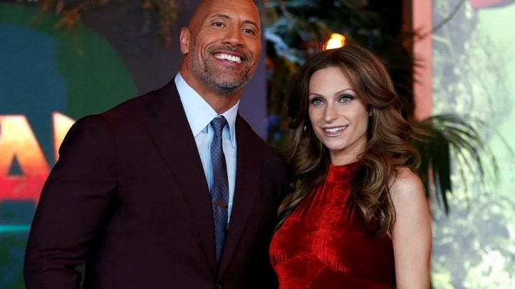 "Cast member Dwayne Johnson and Lauren Hashian pose at the premiere for ""Jumanji: Welcome to the Jungle"" in Los Angeles, California, U.S., December 11, 2017."