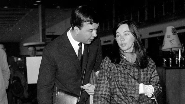 British director Peter Hall and his wife, French actress Leslie Caron and their children Christopher, 3, and Jennifer, 2, arrive at London Airport, England, Sept. 8, 1960. (AP Photo)