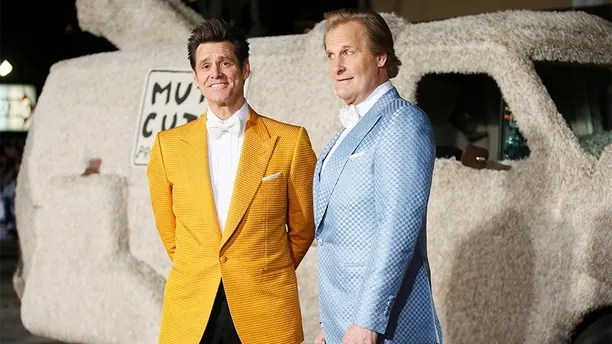 """Actors Jim Carrey (L) and Jeff Daniels arrive in a van decorated as a dog at the world premiere of the film """"Dumb and Dumber To"""" in Los Angeles, November 3, 2014. REUTERS/Danny Moloshok (UNITED STATES - Tags: ENTERTAINMENT) - GM1EAB40ZY501"""