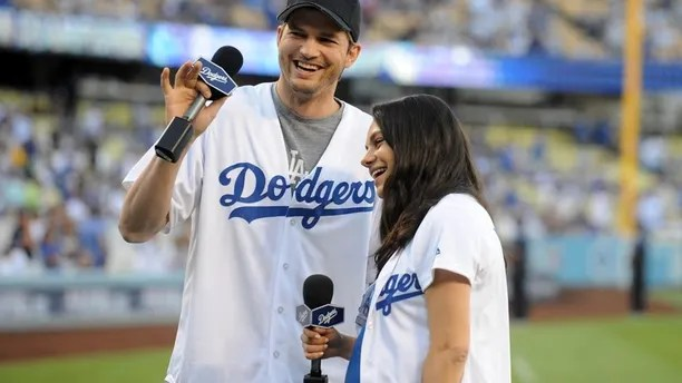 Oct 19, 2016; Los Angeles, CA, USA; Movie stars Ashton Kutcher and Mila Kunis announce the lineup before game four of the 2016 NLCS playoff baseball series between the Chicago Cubs and the Los Angeles Dodgers at Dodger Stadium.