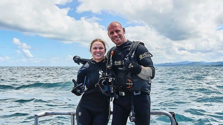 """Ronda Rousey and Paul de Gelder pose before their dive beneath the waters off the Fiji coast. """"Ronda Rousey Uncaged"""" airs Monday, as part of Discovery Channel's annual Shark Week."""
