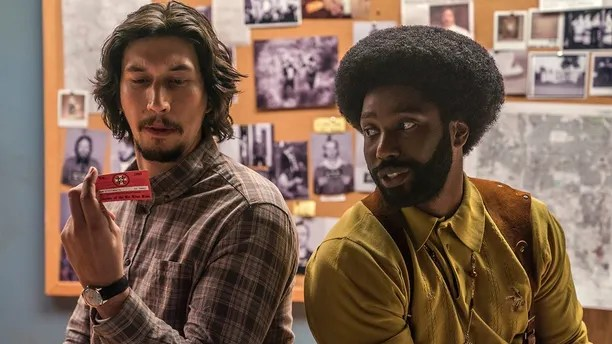"""This image released by Focus Features shows Adam Driver, left, and  John David Washington in a scene from """"BlacKkKlansman."""" (David Lee/Focus Features via AP)"""