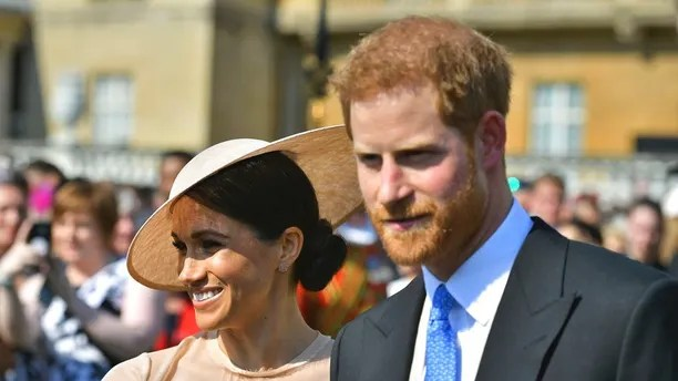 Meghan, the Duchess of Sussex walks with her husband, Prince Harry as they attend a garden party at Buckingham Palace in London, Tuesday May 22, 2018. The event is part of the celebrations to mark the 70th birthday of Prince Charles.  (Dominic Lipinski/Pool Photo via AP)