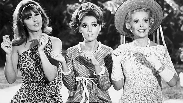 From left to right, sex-kitten Ginger (Tina Louise), girl-next-door Mary Ann (Dawn Wells), and millionairess Mrs. Howell (Natalie Schaefer) in a scene from the 1960s television comedy