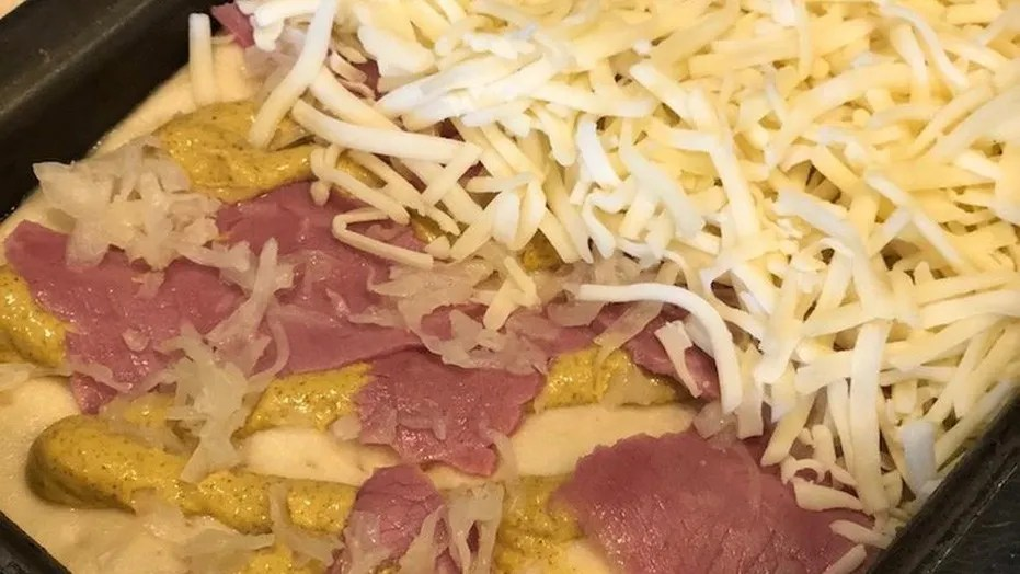 A Detroit-style eatery in New York City uses mustard instead of tomato sauce on one of their pizzas.