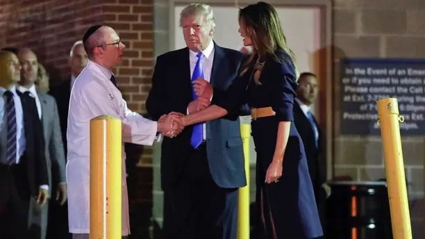 President Donald Trump and first lady Melania Trump with Dr. Ira Y. Rabin, left, after visiting MedStar Washington Hospital Center in Washington, Wednesday, June 14, 2017, where House Majority Leader Steve Scalise of La. was taken after being shot in Alexandria, Va., during a Republican congressional baseball practice. (AP Photo/Pablo Martinez Monsivais)