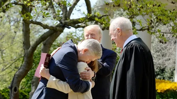 Justice of the Supreme Court Neil Gorsuch hugs his wife Louise during a ceremony at the White House Rose Garden April 10, 2017.Photo by Olivier Douliery/ Abaca(Sipa via AP Images)