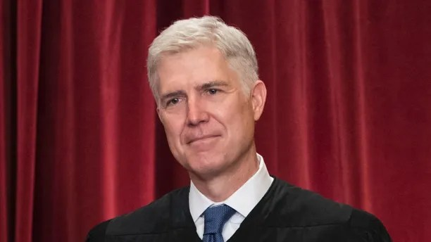 Associate Justice Neil Gorsuch joins other justices of the U.S. Supreme Court for an official group portrait at the Supreme Court Building in Washington, Thursday. June 1, 2017. Neil Gorsuch was nominated by President Donald Trump in 2017. (AP Photo/J. Scott Applewhite)