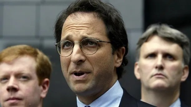 Federal prosecutor Andrew Weissmann (C) is flanked by FBI agents as he speaks to the press outside the federal courthouse in Houston, Texas about the latest round of indictments stemming from the collapse of Enron, May 1, 2003. Also Lea Fastow, wife of Enron Chief Financial Officer Andrew Fastow, is expected to be indicted on tax and mail fraud. REUTERS/Jeff Mitchell JM/ME - RTRMRJX