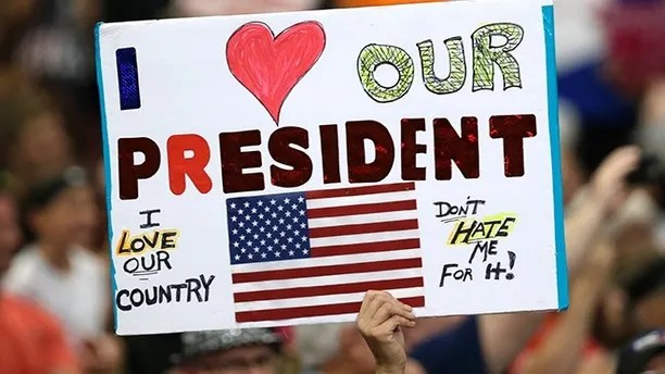 A supporter holds up a sign as President Donald Trump speaks at the Covelli Centre, Tuesday, July 25, 2017, in Youngstown, Ohio. (AP Photo/Tony Dejak)
