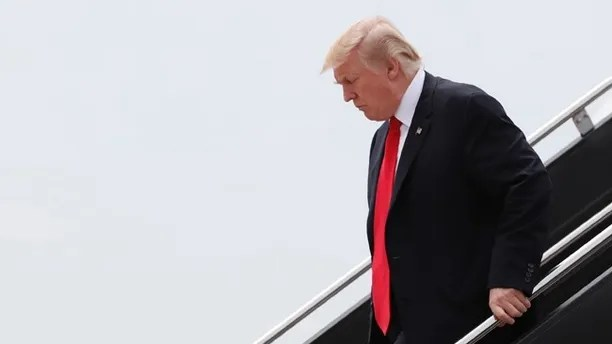 President Donald Trump arrives on Air Force One at Dulles International Airport in Dulles, Va., Saturday, July 22, 2017, after attending the commissioning ceremony of the aircraft carrier USS Gerald R. Ford (CVN 78) at Naval Station Norfolk, Va. (AP Photo/Carolyn Kaster)