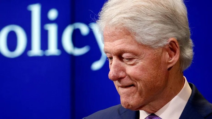 """Former President Bill Clinton pauses while speaking at a Brookings Institution forum to discuss the book """"Yitzhak Rabin: Soldier, Leader, Statesman"""" in Washington, U.S., March 9, 2017."""