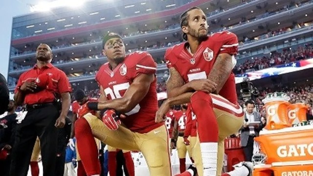 San Francisco 49ers players Eric Reid (35) and Colin Kaepernick (7) kneel during the national anthem before an NFL game in Santa Clara, Calif., Sept. 12, 2016.