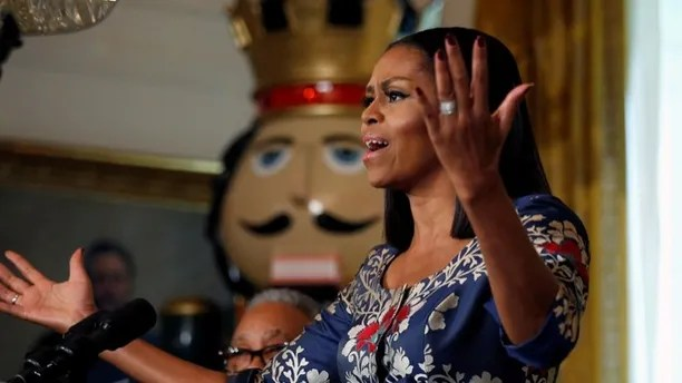 First lady Michelle Obama speaks during an event welcoming military families to the White House to view the holiday decorations in Washington, U.S., November 29,  2016.  REUTERS/Kevin Lamarque - RC1C6BAEF700