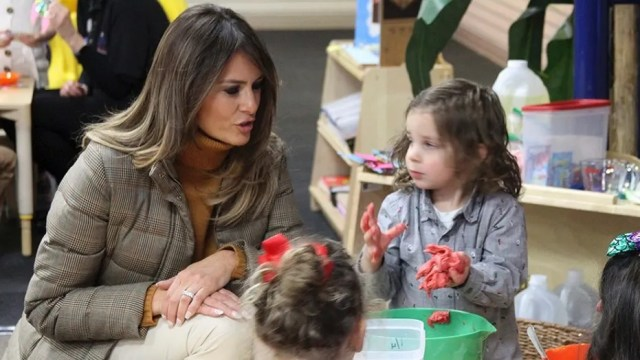 First lady Melania Trump watches as children form objects from Play-Doh at Joint Base Elmendorf-Richardson, Alaska, on Friday, Nov. 10, 2017. Trump visited with children taking part in programs for the children of military members at the base in Anchorage, Alaska, before flying back to Washington, D.C. (AP Photo/Mark Thiessen)