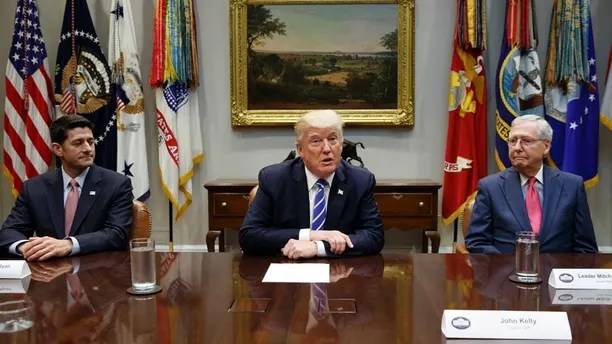 FILE - In this Sept. 5, 2017, file photo, House Speaker Paul Ryan, R-Wis., left, and Senate Majority Leader Mitch McConnell, R-Ky., right, listen as President Donald Trump speaks during a meeting with Congressional leaders and administration officials on tax reform, in the Roosevelt Room of the White House in Washington. Taxes, spending, immigration, and more, top a daunting agenda when Congress returns to Washington on Monday, Nov. 27, 2017. It's a critically important moment for the president and his GOP allies controlling Congress, who are still reaching for their first major Capitol Hill win. Tax cuts would fit the bill. (AP Photo/Evan Vucci, File)