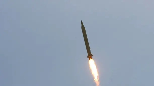 EDITORS' NOTE: Reuters and other foreign media are subject to Iranian restrictions on their ability to film or take pictures in Tehran.  A Ghadr 1 class Shahab 3 long range missile is launched during a test from an unknown location in central Iran September 28, 2009. Iran test-fired the missile on Monday which defence analysts have said could hit Israel and U.S. bases in the Gulf, state media reported, a move that may irk world powers ahead of rare talks with Tehran this week.  REUTERS/Fars News/Ali Shayegan (IRAN MILITARY POLITICS) QUALITY FROM SOURCE - GM1E59S1FIM01