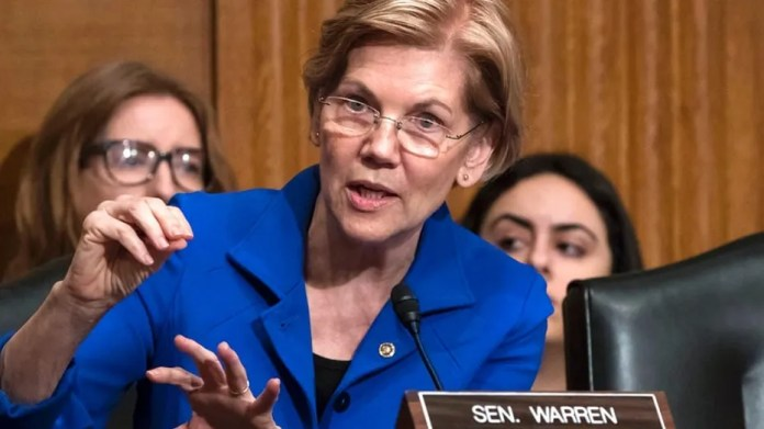 Sen. Elizabeth Warren, D-Mass., asks questions during a congressional hearing in December.