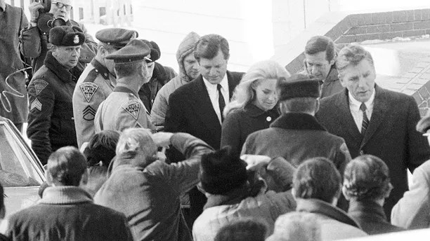 Sen. Edward M. Kennedy and wife Joan approach Dukes County court house in Edgartown Monday, Jan. 5, 1970 where he will testify at inquest into death of Mary Jo Kopechne. Miss Kopechne was killed in car driven by the senator when it went off bridge on Chappaquiddick Island and into a pond last July 18. (AP Photo)