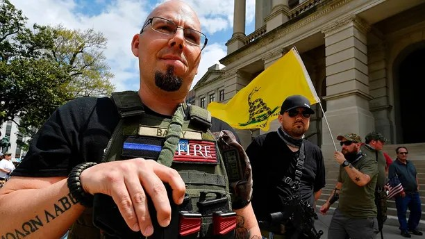 Shaun Baby, of Cartersville, Ga., participates in a gun-rights rally at the state capitol, Saturday, April 14, 2018, in Atlanta.  About 40 gun rights supporters have gathered for one of dozens of rallies planned at statehouses across the U.S.   (AP Photo/Mike Stewart)