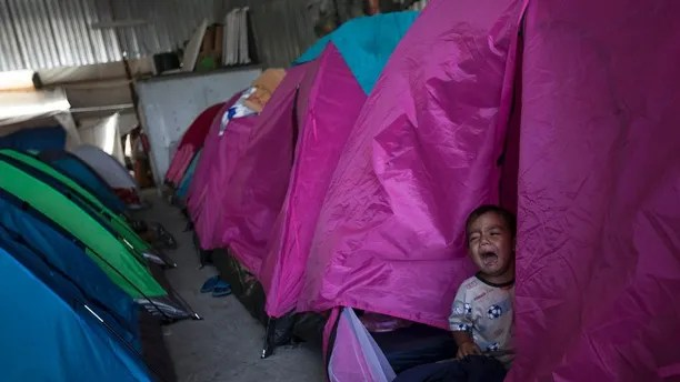 A Honduran migrant toddler who is traveling with a caravan of Central American migrants cries inside a tent set up at the Juventudes 2000 shelter in Tijuana, Mexico, Wednesday, April 25, 2018. The caravan of mainly Central American migrants are planning to request asylum, either in the United States or Mexico. (AP Photo/Hans-Maximo Musielik)