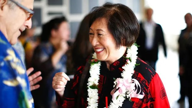 In this April 28, 2018 photo, U.S. Rep. Colleen Hanabusa, D-Hawaii, who is giving up her seat in Congress to run for Hawaii governor, talks with a guest at an event in Honolulu. Hawaii Gov. David Ige faces a stiff challenge from Hanabusa in the Democratic primary on Saturday, Aug. 11, 2018. (AP Photo/Marco Garcia, File)