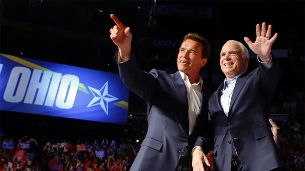 U.S. Republican presidential nominee Senator John McCain (R-AZ) (R) is joined by California Governor Arnold Schwarzenegger at a campaign rally in Columbus, Ohio October 31, 2008. McCain is on a two-day campaign bus tour through the state of Ohio. REUTERS/Brian Snyder (UNITED STATES) US PRESIDENTIAL ELECTION CAMPAIGN 2008 (USA) - GM1E4B10JME01