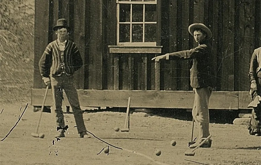 Experts have identified Billy the Kid as the man standing in the left of this picture, wearing a top hat. (Credit: Kagin's)