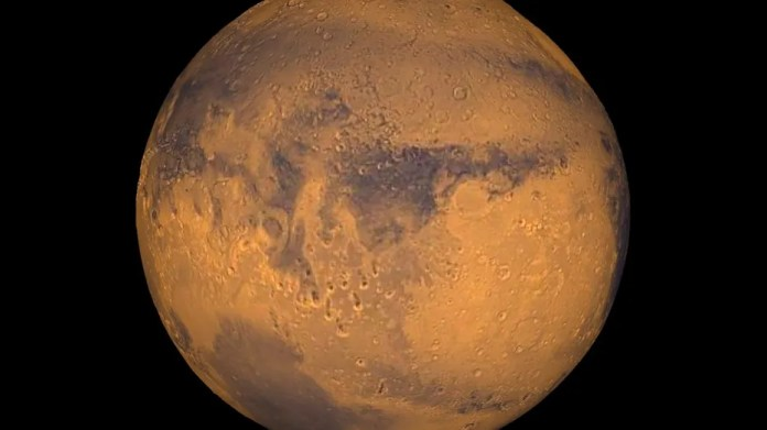 NASA's Mars Reconnaissance Orbiter has discovered one place on the red planet that held a whole bunch of the life-giving liquid: an incredibly massive lake that, during its peak, held ten times the amount of water of all the Great Lakes, combined. (REUTERS/NASA/Greg Shirah)