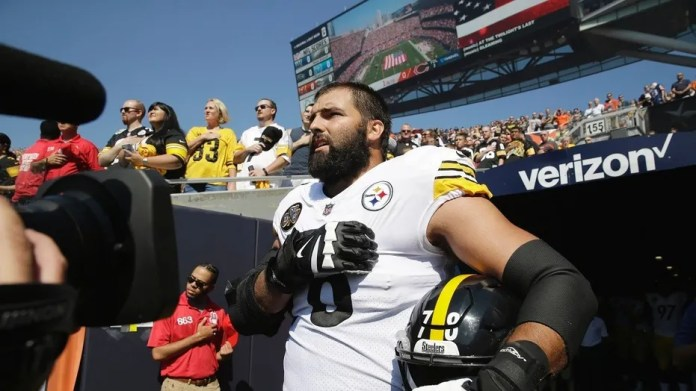 Pittsburgh Steelers offensive tackle and former Army Ranger Alejandro Villanueva stands for the national anthem.