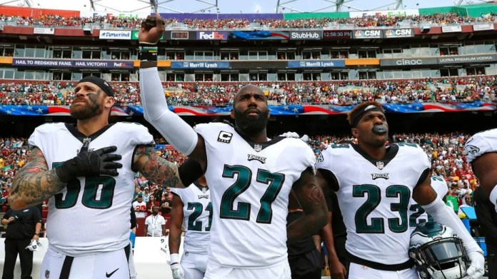 Philadelphia Eagles' Malcolm Jenkins, center, would keep protesting during national anthem even if it meant his benching.