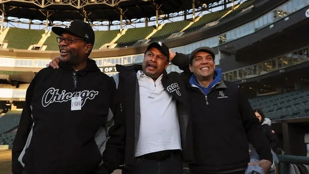 Chicago White Sox groundskeeper Nevest Coleman, center, laughs with friend and fellow grounds crew Harry Smith Jr., left, and friend and now supervisor Jerry Powe, at Guaranteed Rate Field in Chicago, Monday, March 26, 2018. The Chicago Tribune reports that DNA evidence led prosecutors last year to vacate the conviction of 49-year-old Nevest Coleman. He'd been convicted in a 1994 rape and murder. He was released from prison in November and declared innocent last month. (Nancy Stone/Chicago Tribune via AP)