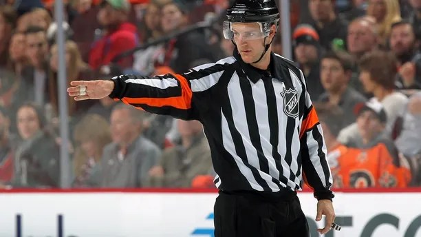PHILADELPHIA, PA - NOVEMBER 12:  Referee Garrett Rank #7 signals a good goal following a review during a NHL game between the Philadelphia Flyers and the Minnesota Wild on November 12, 2016 at the Wells Fargo Center in Philadelphia, Pennsylvania.  (Photo by Len Redkoles/NHLI via Getty Images)
