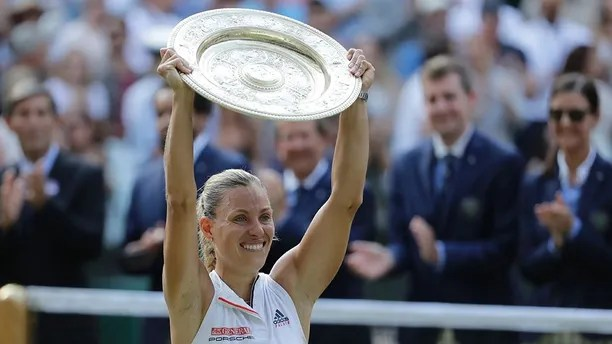 Germany's Angelique Kerber lifts the trophy after winning the women's singles final match against Serena Williams of the United States, at the Wimbledon Tennis Championships, in London, Saturday July 14, 2018.(AP Photo/Ben Curtis)