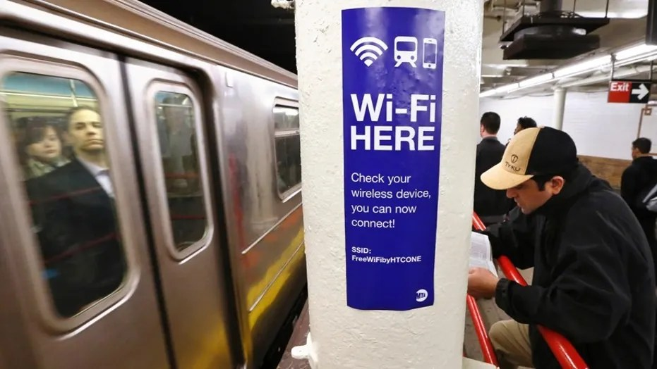 File photo: A sign advertises Wi-Fi service in the Times Square Subway station in New York, April 25, 2013. REUTERS/Brendan McDermid