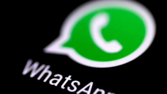 File photo: The WhatsApp messaging application is seen on a phone screen August 3, 2017. (REUTERS/Thomas White)