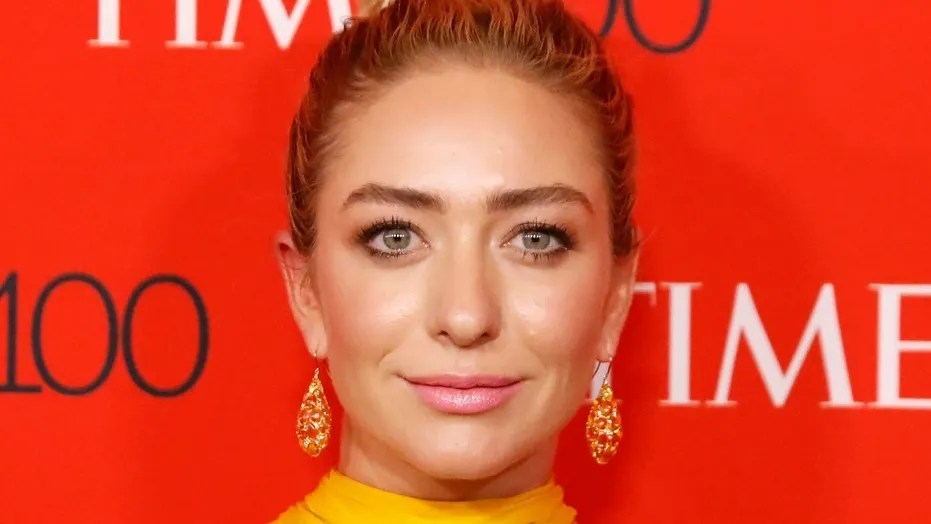 Bumble CEO Whitney Wolfe Herd has her photo taken on the red carpet after arriving for the TIME 100 Gala in Manhattan, New York, U.S., April 24, 2018. REUTERS/Shannon Stapleton - RC1C8E20D780