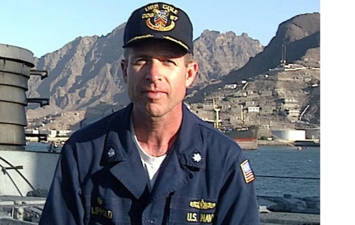 "001000-N-0000X-004 ABOARD USS COLE October, 2000 -- VIDEO ""FRAME GRAB"" of Commander Kirk Lippold, USS Cole (DDG 67) from videotaped message to friends and family members of the crew aboard USS Cole following a 12 Oct. terrorist attack on the ship while refueling in Aden, Yemen. The text of Commander Lippold's message is located at Http://Www.Navy.Mil. U.S. Navy Photo. (RELEASED)"